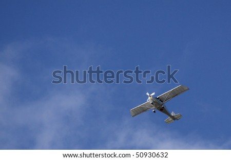 Small aircraft as background with copy space - stock photo