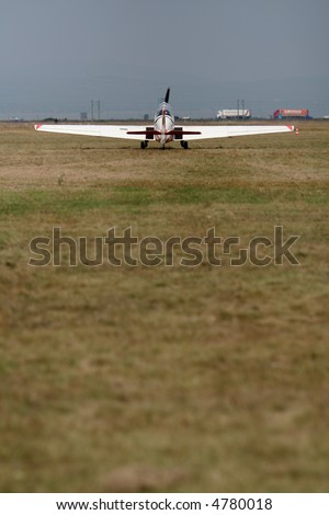 Small airplane doing aerial acrobatics at low altitude, take-off action - stock photo