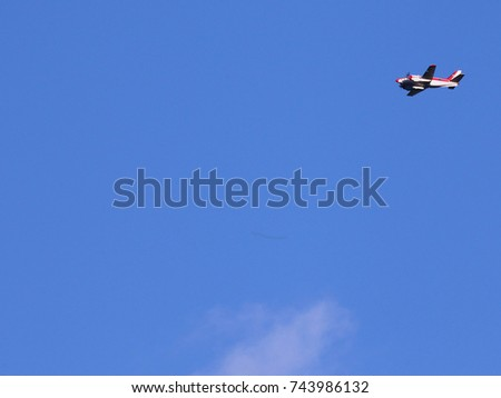 Small Airplane in Bright Blue Sky - Photograph of a small airplane flying overhead in a bright blue sky.  Space for text.