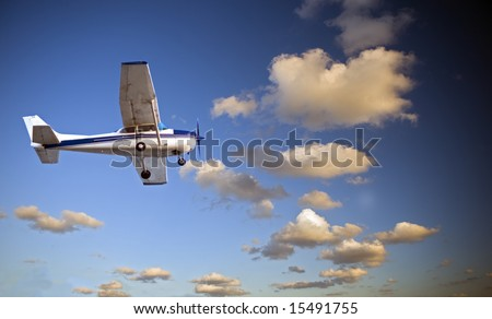 small airplane in twilight - stock photo