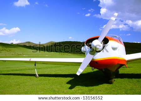 small airplane on the ground - stock photo