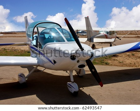 Small airplane with a propeller in    desert airport - stock photo