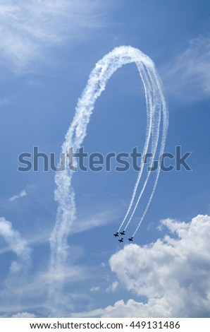 Small airplanes on air show with smoky trail - stock photo