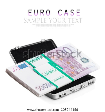 small aluminum suitcase full of euro. Focus on the bills and the European flag - stock photo