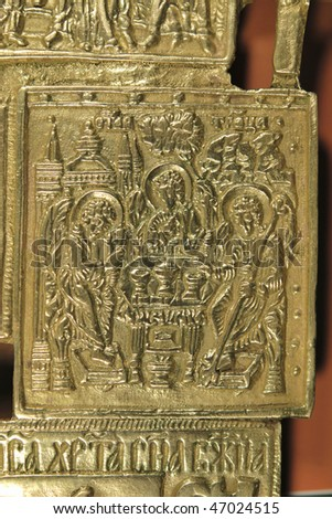 Small ancient icon of Trinity, coated with gold