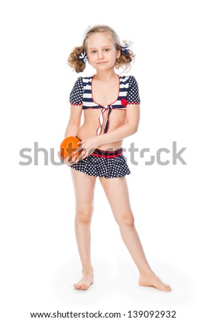 small and beautiful girl with orange