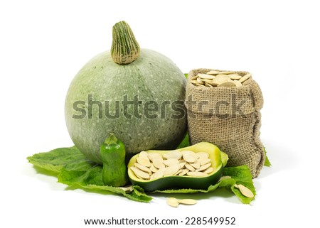 Small and Big Pumpkins and Pumpkin Seeds in Jute Bag on Green Leaf Isolated on White Background - stock photo