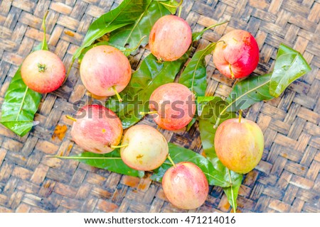 Small apples on wood