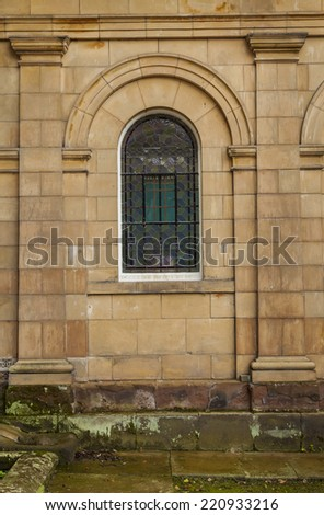 Small arched window of an early nineteenth century mansion - stock photo