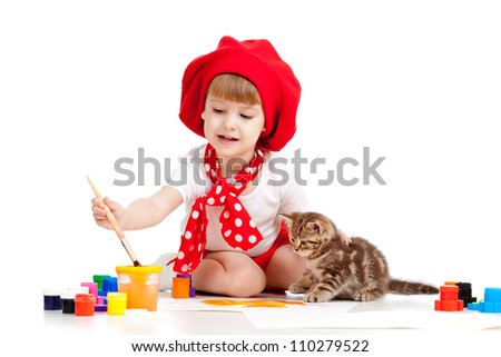 small artist child painting with kitten - stock photo