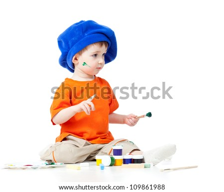 small artist kid with paints and brush