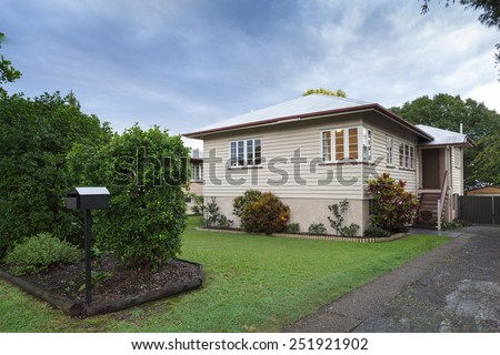 Small australian wooden home in the suburbs - stock photo