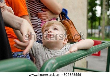 Small baby boy is enjoing his time in the park