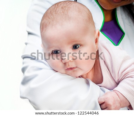 Small baby in doctors hands isolated on a white background - stock photo