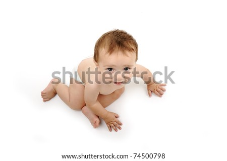 small baby is looking up, isolated - stock photo