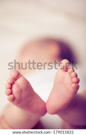 Small baby - newborn feet, macro - stock photo