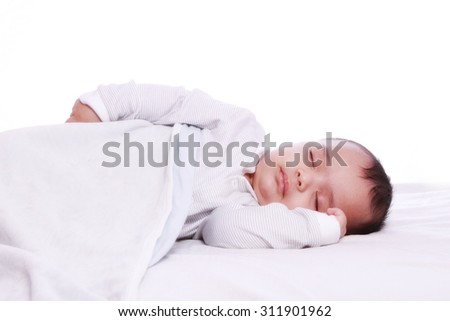 Small baby sleeping Under white blanket , Photographed against white background - stock photo