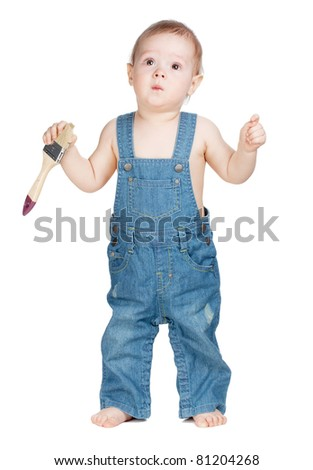 Small baby worker with paint brush - stock photo