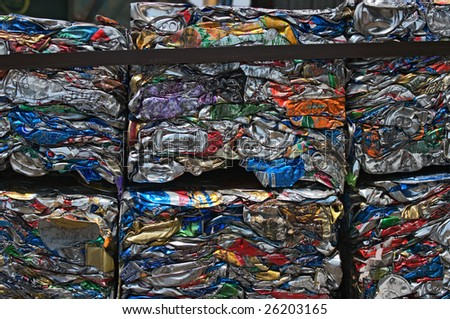 Small bales of compacted cans for recycling - stock photo