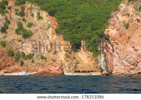 Small beach and green hills on the coastal line of Adriatic sea - stock photo