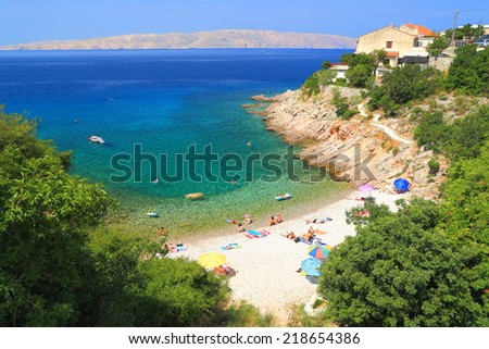 Small beach hidden by vegetation near the Adriatic sea, Senj, Croatia - stock photo