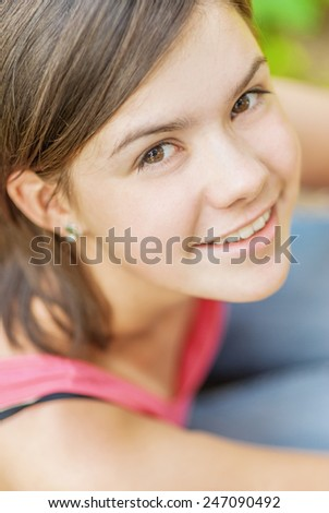 Small beautiful girl close up looks in camera - stock photo