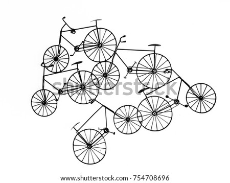 small bicycle hanging on white wall texture background