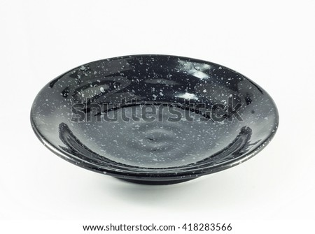 Small black bowl isolated on white background.copy space and selective focus - stock photo
