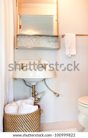 Small blue bathroom with antique sink and white. - stock photo