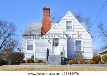 Small Blue French Cottage Home - stock photo
