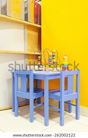 Small blue table and two chairs for little kids  - stock photo