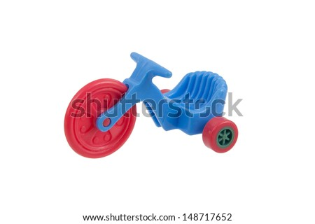Small blue tricycle toy, isolated on white - stock photo