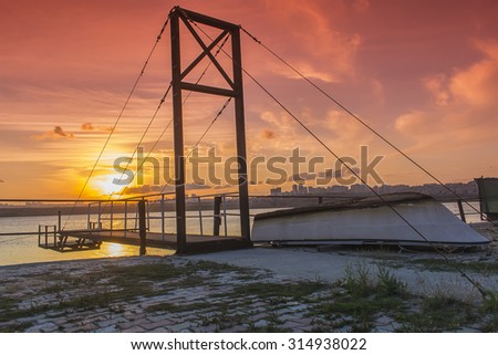 Small Boat Near the Wooden Pier that suspended with Sunset