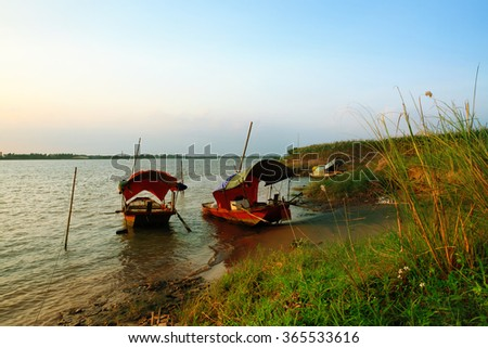 small boat of Vietnam transportation sales people across the river in sunset