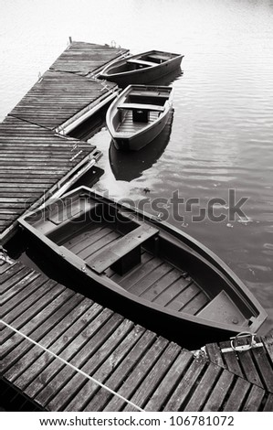 Small boat on a lake - stock photo