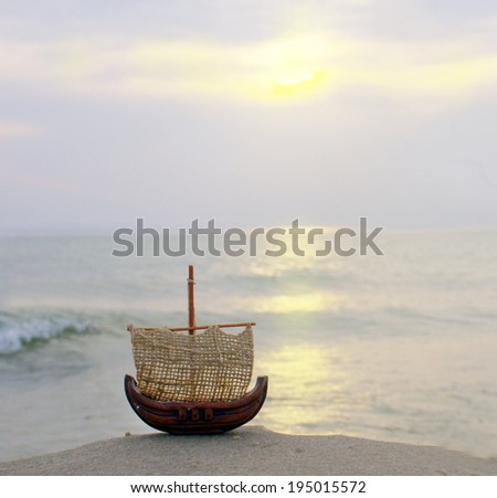 Small boat on blue water
