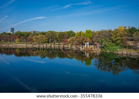 Small boat on canal around Osaka Castle park in Japan - stock photo