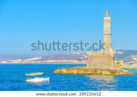 Small boats at the venetian lighthouse at Chania, Crete - stock photo