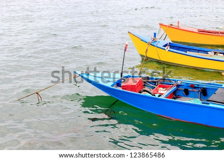Small boats for fishing and water beautiful colors.