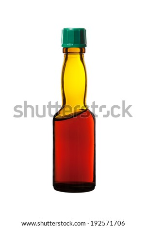 small bottle of balsam  on a white background  - stock photo