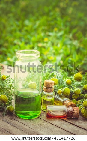 Small bottle of cosmetic chamomile scented oil