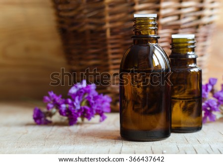 Small bottles of essential oil - stock photo