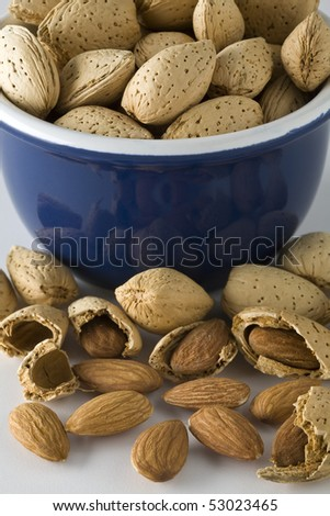 Small bowl full of raw almonds - stock photo