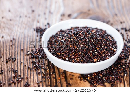 Small bowl with a portion of black Quinoa (close-up shot) - stock photo