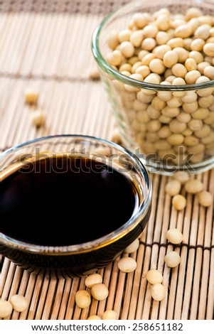 Small bowl with Soy Sauce (on Bamboo background) - stock photo