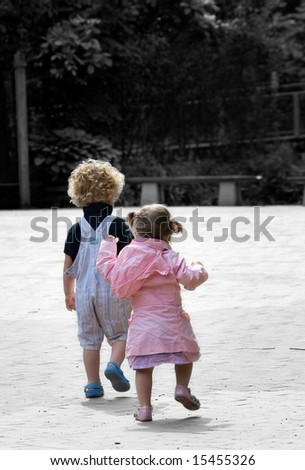 small boy and baby girl on adventure( Black and white background) - stock photo