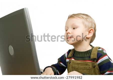 small boy gets knowledge with laptop isolated on white - stock photo
