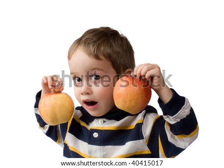 small boy holds two apples