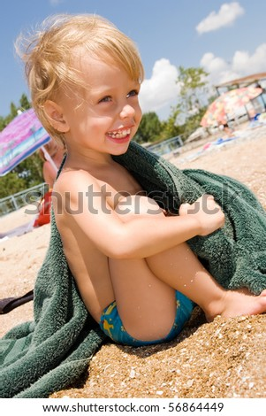 Small boy laughing at the seaside