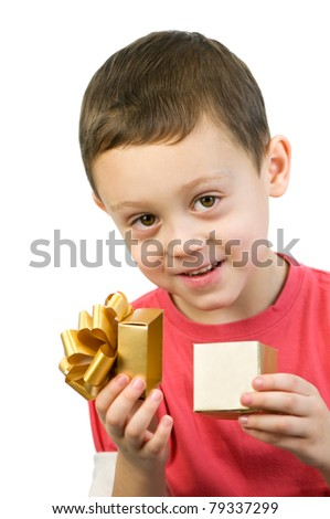 small boy looking inside box - stock photo